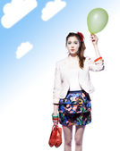 Funny girl with a balloon — Stock Photo