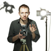 Photographer with retro camera in studio — Zdjęcie stockowe