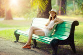 Girl sitting on a bench — Stock Photo