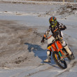 Motocross rider performs a right turn with the skid - Stock Photo