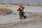 Winter MX, rider goes with proslipping through the rear wheel — Stock Photo