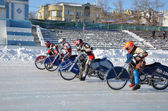 Racing on ice track on a motorcycle start — Stock Photo