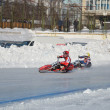 Royalty-Free Stock Photo: Ice Speedway, two rival motorcyclists on corner exit