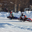 Stock Photo: Ice Speedway, two rival motorcyclists on corner exit