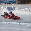 Stock Photo: Speedway on ice, turn on a two motorcycle