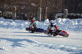 Ice Speedway, two rival motorcyclists on corner exit — Stock Photo