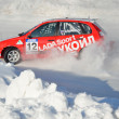 Sports car turns into skid on icy track — Stock Photo #9003992