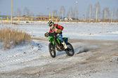 Motocross racer turns with proslipping — Stock Photo