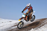 Motocross racer flying down the mountain — Stock Photo