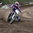 Постер, плакат: Departure with acceleration out of the left turn motocross racer