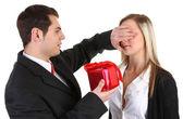 A guy giving a girl a present — Stock Photo