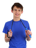 A guy wearing a blue shirt with a skipping rope — Stock Photo