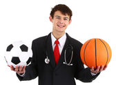 A doctor with a football and a basketball — Stock Photo