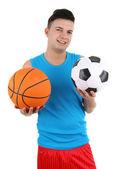 拿着足球和篮球的家伙 — 图库照片