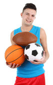 Guy holding different sports balls — Stock Photo