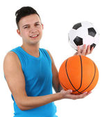 Guy with a football and a basketball — Stockfoto
