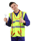 Guy with a spanner and cables — Stockfoto