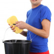 A guy with a bucket and a sponge — Stock Photo