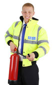 Security guard with a fire extinguisher — Stock Photo
