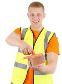 A guy with a brick — Stock Photo