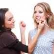 Make up artist applying lipstick to the model — Stock Photo