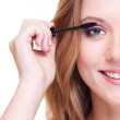 Close up portrait of smiley woman doing make up — Stock Photo