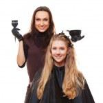 Studio picture of hairdresser doing hair dye — Stock Photo