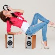 Studio shot of young woman listening the music — Stock Photo #10131045