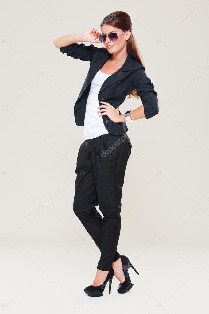 Fashion model in studio. grey background — Stock Photo #10130841