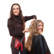 Beautiful hairdresser and smiley client — Stock Photo