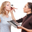 Make up artist with beautiful model — Stock Photo