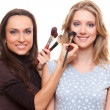Studio picture of smiley make up artist and client — Stock Photo