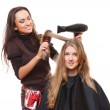 Hairdresser and young woman — Stock Photo