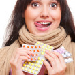 Studio shot of funny woman with pills — Stock Photo #10476769