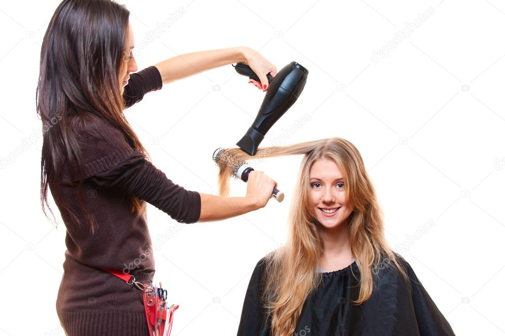 Studio shot of hairdresser with hairdryer. isolated on white — Stock Photo #10476708