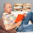 Senior man reading books — Stock Photo #10530648
