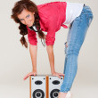 Studio shot of smiley woman with speakers — Stock Photo #10530656