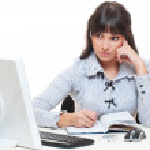 Studio picture of thoughtful secretary writing something — Stock Photo #10557582