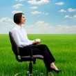 Businesswoman relaxing at the meadow with cup of coffee — Stock Photo