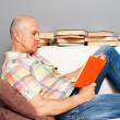 Man at home reading the book — Stock Photo #10659078