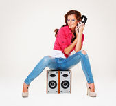 Studio shot of young woman listening the music — Foto Stock