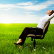 图库照片: Businesswomrelaxing on chair