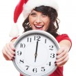 Excited girl with santa hat holding clock - Foto de Stock