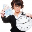Woman holding money and clock — Stock Photo #8130138