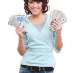 Euro y mujer holding dólares — Foto de Stock