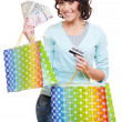 Woman holding money shopping bags — Stock Photo