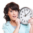 Surprised woman with clock — Stock Photo