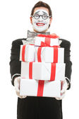 Mime holding many boxes of presents — Stock Photo