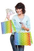 Woman holding money shopping bags — Stok fotoğraf