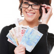 Businesswoman holding euro - Stock Photo